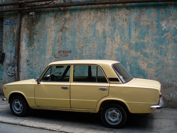 A pale yellow Lada