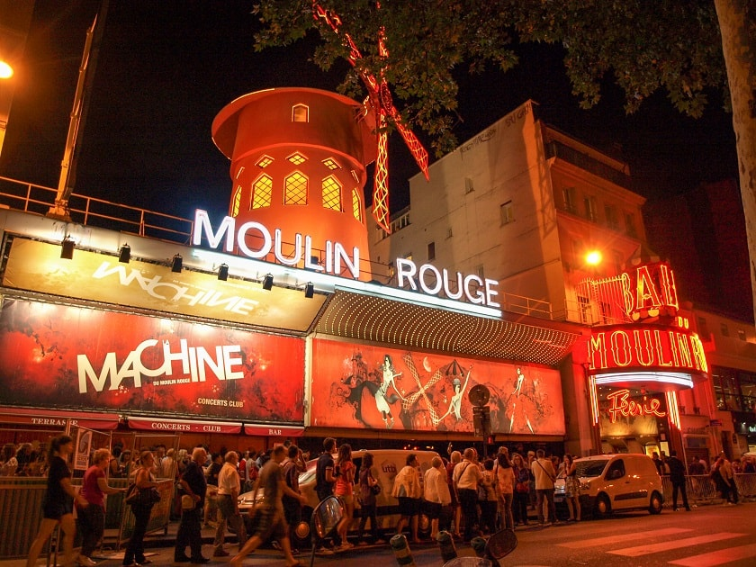 People waiting in line for Moulin Rouge