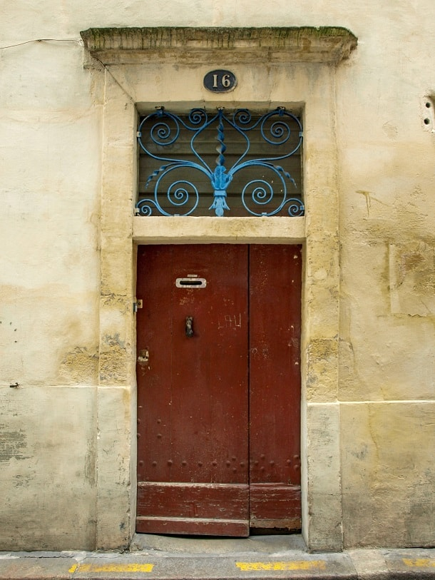Red door with blue iron decoration