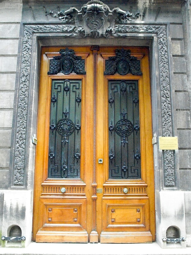 Wooden door with iron protected glass