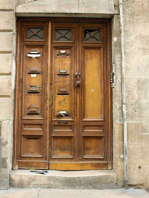 Wooden door with letter boxes