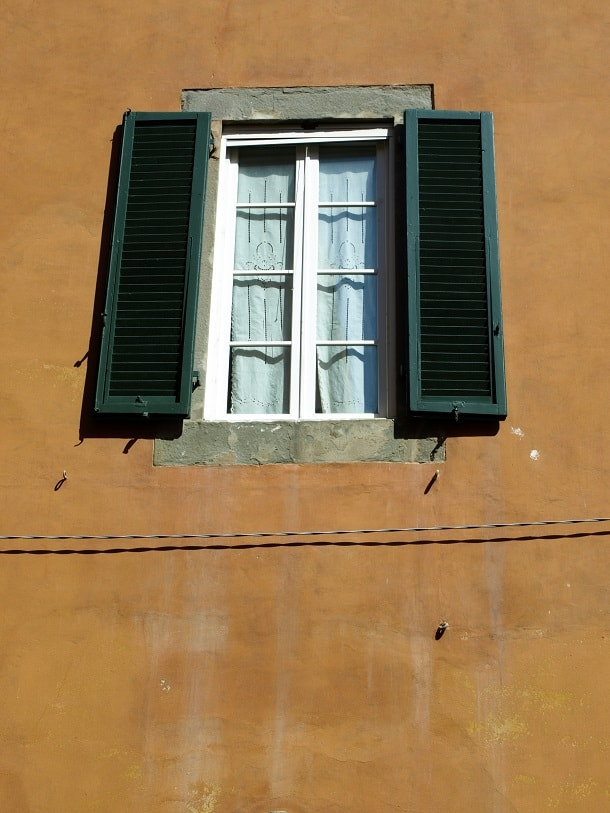 Window and shutters in Pisa