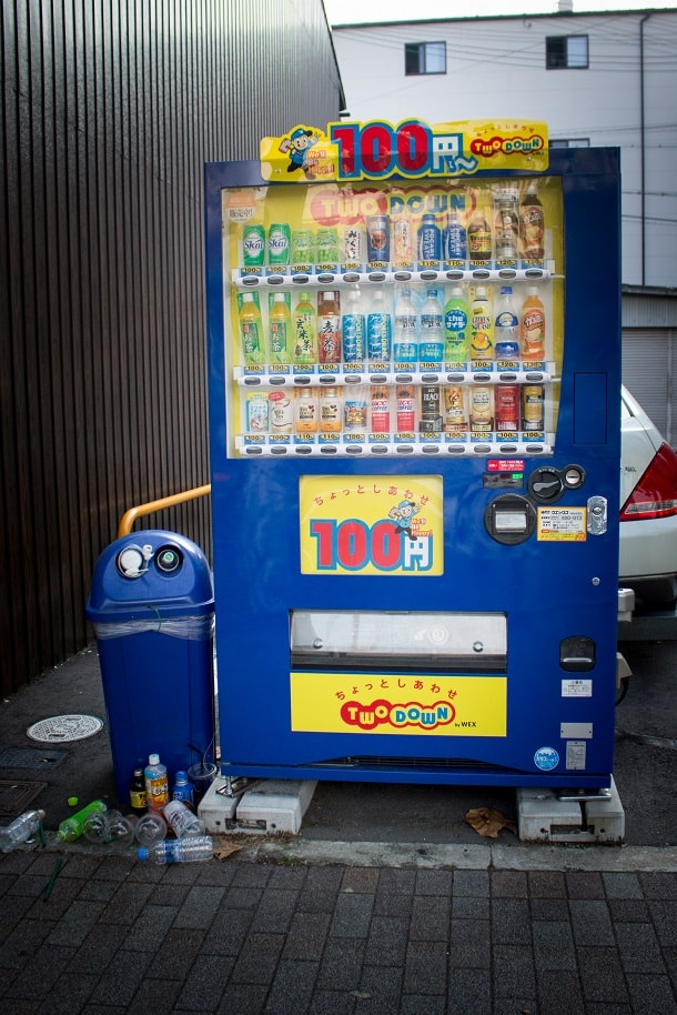Soda machine with attached garbage can